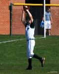 Left fielder snags a pop fly