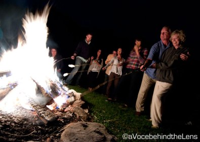The guests make their way down to the bonfire for s'mores before turning in for the wedding!