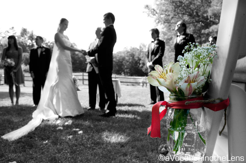Each row of chairs was flanked by a mason jar with flowers in it. This photograph was meant to highlight that piece.