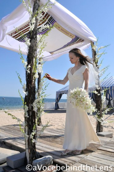The bride gives her approval on the chuppah. The flowers definitely added a wonderful touch.